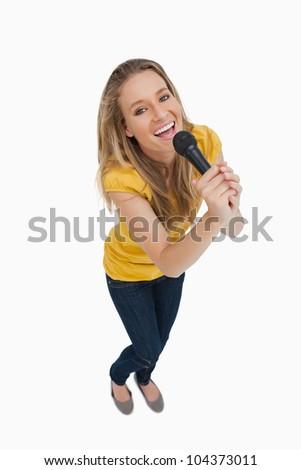 Halszem kilátás mosolyog szőke nő énekel mikrofon Stock fotó © wavebreak_media