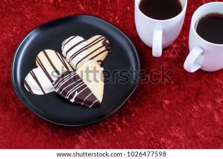 Stock photo: Chocolate dipped heart shaped shortbread cookies and a cup of ca
