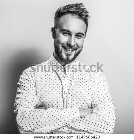 fashion young handsome man black and white photo studio portra stock photo © victoria_andreas