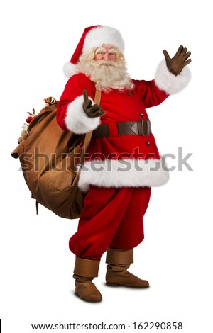 full length of real santa claus carrying big bag full of gifts stock photo © hasloo
