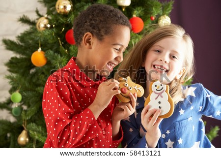 two young children eating christmas treats in front of christmas stock photo © monkey_business