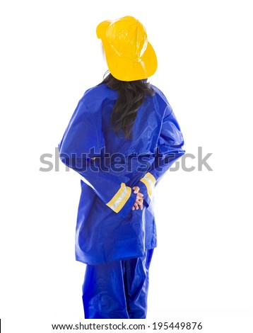 Back view of a lady firefighter in blue protective suit wearing yellow helmet Stock photo © bmonteny