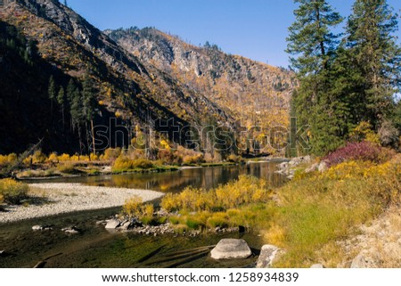 fall yellow blue green colors reflection wenatchee river valley stock photo © billperry