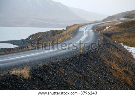 Winding road bends in  rural, desolate, mountain landscape.  Europe. Stock photo © master1305