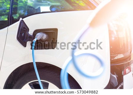 Electric car being charged at the station, close up of the power Stock photo © vladacanon