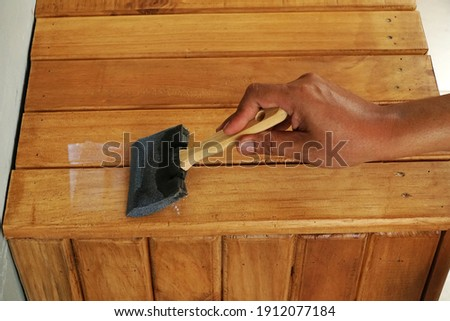 worker or carpenter, hand splash painted or repair, wooden chair Stock photo © FrameAngel