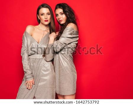 Сток-фото: красивой · молодые · Sexy · брюнетка · девушки · красное · платье