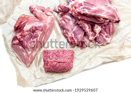Pieces of fresh raw pork appetizing close-up on a white porcelain plate on a wooden background. Stock photo © mcherevan