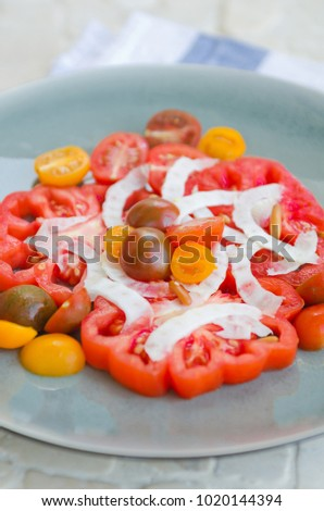A vibrant healthy mixed tomato, mozzarella, pine nut and balsamic vinegar salad, served on a rustic  stock photo © dannyburn