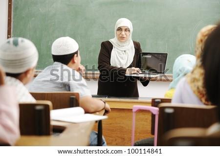 Education activities in classroom at school, Muslim teacher showing Koran to kid Stock photo © zurijeta