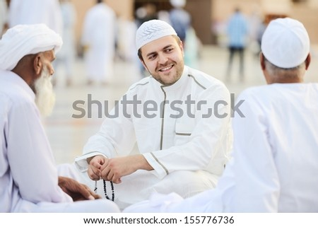Small group of middle eastern friends sitting and talking outdoo Stock photo © zurijeta