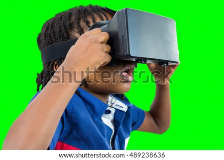 Composite image of profile view of little boy holding virtual gl Stock photo © wavebreak_media