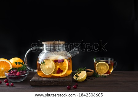 Citrus punch in the glass on the dark table with Christmas decorations Stock photo © Karpenkovdenis