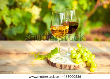 Green grapes and two glasses of the white and red wine on the vi Stock photo © Yatsenko