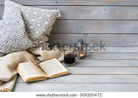 Cushions, plaid, lantern, black coffee and old book on the white Stock photo © Yatsenko