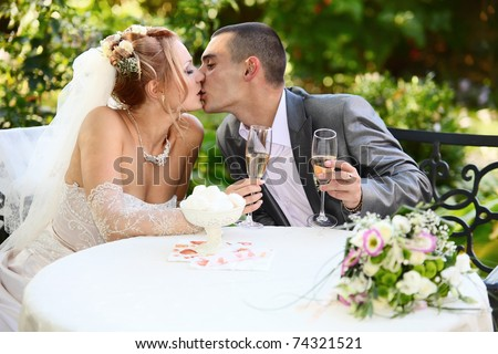 happy playful woman holding two glasses of champagne and winking stock photo © deandrobot