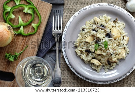 risotto with mushrooms and chicken on a white plate on a wooden stock photo © yatsenko