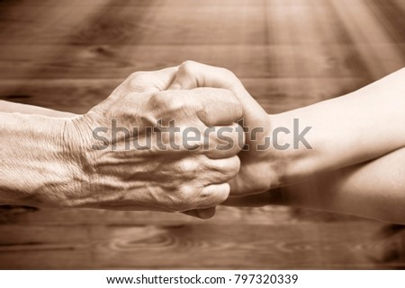 Handshake between an old person with a wrinkled hand and a kid Stock photo © OlgaYakovenko