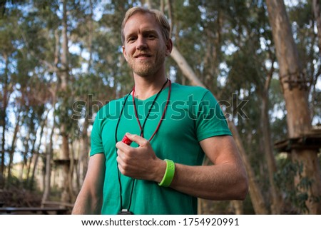 Trainer holding whistle in his hands on a sunny day in the forest Stock photo © wavebreak_media