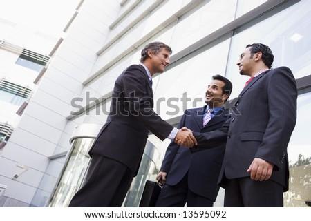 empresario · pie · fuera · oficina · mirando - foto stock © monkey_business