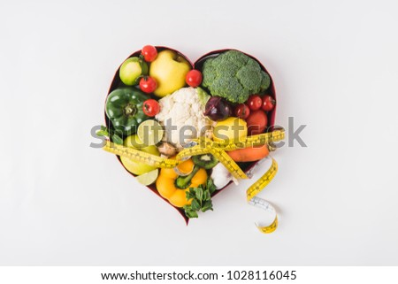 vegetables and fruits laying in heart shaped dish isolated on white background    Stock photo © LightFieldStudios