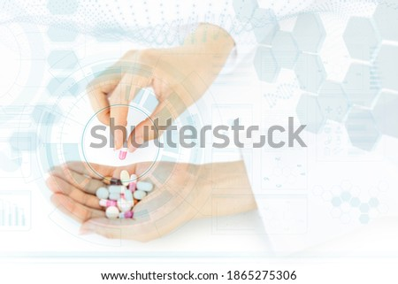 Close-up of the hand of female pharmacist picking up the best product Stock photo © Kzenon