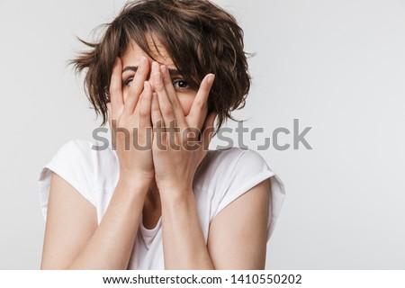 Fotó zavart zaklatott fiatal nő fehér póló Stock fotó © deandrobot