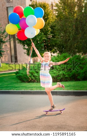 Happy Little Girl Skating On A Scateboard With Large Bunch Of Helium Filled Colorful Balloons Foto d'archivio © Len44ik