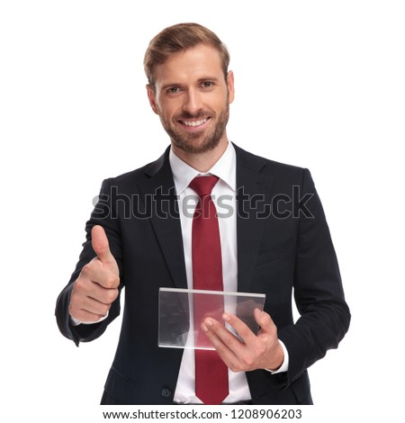 portrait of businessman with futuristic gadget making ok sign stock photo © feedough