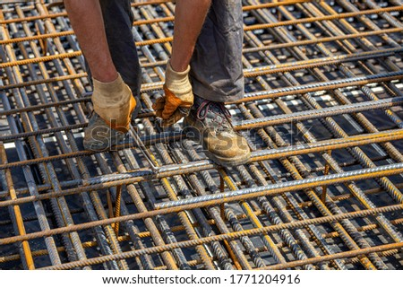 Worker Securing Steel Rebar Framing With Wire Plier Cutter Tool  Stock photo © feverpitch