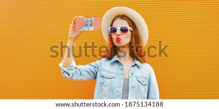 photo of happy woman 20s wearing sunglasses and straw hat smilin stock photo © deandrobot