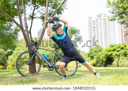 Image of healthy asian guy in casual wear stretching his body, w Stock photo © deandrobot