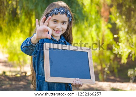 Cute Young Mixed Race Girl With Okay Sign Holding Blank Blackboa Stock photo © feverpitch