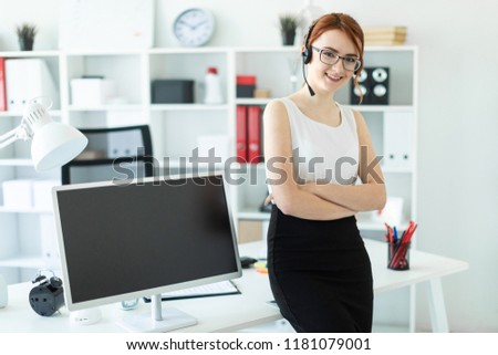 A beautiful young girl in headphones with a microphone sat on the desk in the office. Next to the gi Stock photo © Traimak