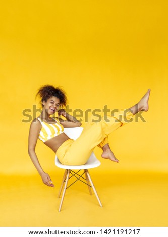 Image of glamour woman 20s wearing casual clothing sitting on fl Stock photo © deandrobot