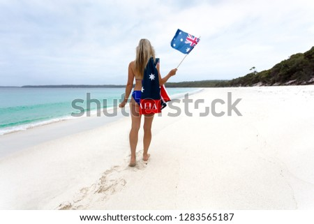 Aussie girl walking along pristine beach with Australian flag Stock photo © lovleah