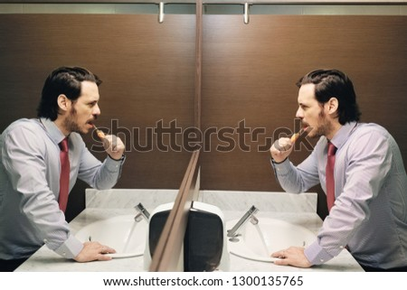 Business Man Brushing Teeth After Lunch Break In Office Bathroom Stock photo © diego_cervo