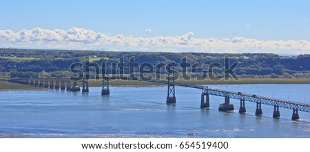 long suspension bridge spans the St. Lawrence River between Montmorency and the scenic island of Ile Stock photo © Lopolo