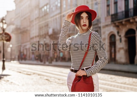 Fashionable spring look with black and white striped overalls. Stock photo © studiolucky