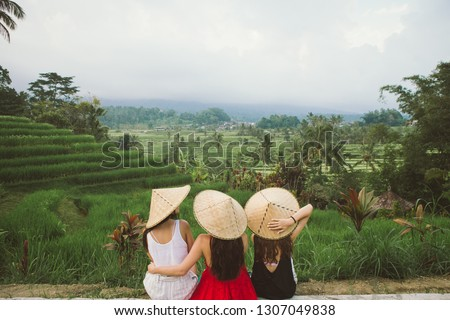 Young woman traveler on Beautiful Jatiluwih Rice Terraces against the background of famous volcanoes Stock photo © galitskaya