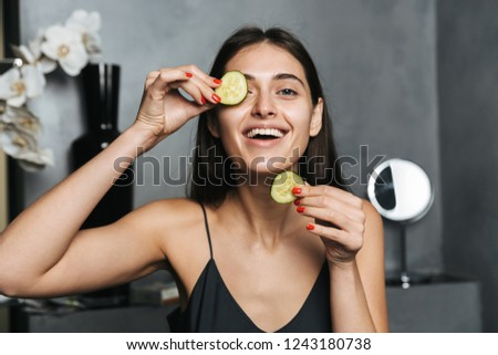 photo of cheerful woman with long dark hair and clean skin touch stock photo © deandrobot