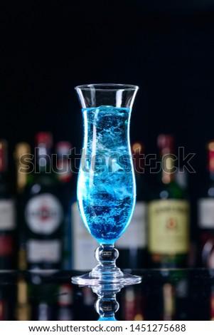 Barman at work, preparing cocktails. Pouring blue lagoon cocktai Stock photo © dashapetrenko