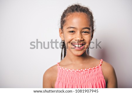 Photo stock: Cute nine years old child with pink dress on studio white background