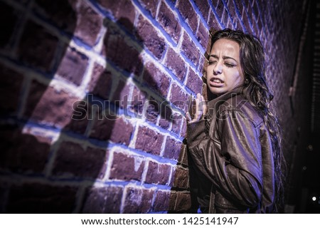 Male Shadow Figure With Knife Threatens Frightened Young Woman A Stock photo © feverpitch