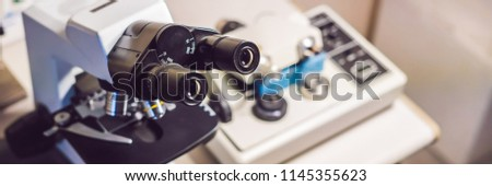 precision micrometer grinder polishing machine with a big optical microscope standing by BANNER, lon Stock photo © galitskaya