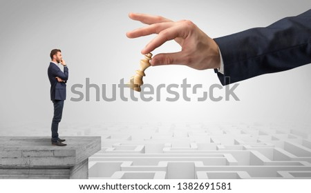 little businessman from the top of the labyrinth thinking about strategies stock photo © ra2studio