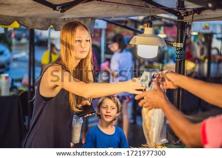 mother and son are tourists on walking street asian food market banner long format stock fotó © galitskaya
