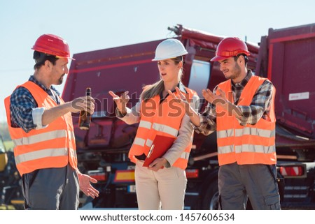 Employee of a freight forwarding drinking alcohol during work time Stock photo © Kzenon