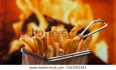 French fries served in metallic mesh recipient - on fire backgro Stock photo © lightkeeper
