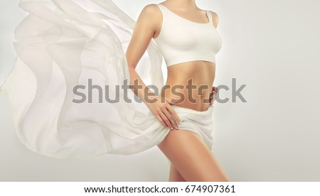 perfect slim toned young body of the girl an example of sports fitness or plastic surgery and ae stock photo © serdechny